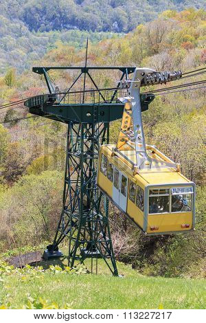 Aerial Ropeway Cabin Flying Over The Avalley