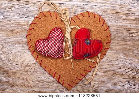 Colorful Fabric Hearts On Wooden Backgrounds
