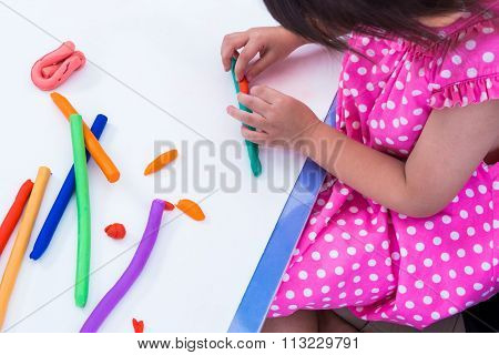 Child Moulding Modeling Clay. Strengthen The Imagination