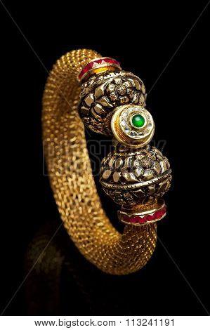 Close up of golden bangle.