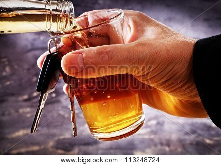 Man Holding Car Key And Glass With Alcohol