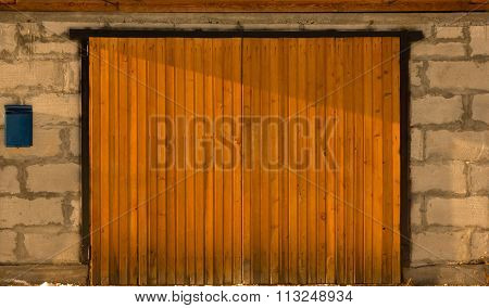 garage doors and brick wall with mailbox background