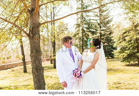 young wedding couple  in funny big glasses