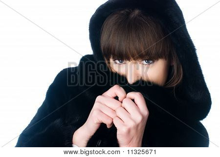 Girl in black fur coat at isolated background poster