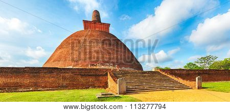Jetavanaramaya dagoba in the ruins of Jetavana in the sacred world heritage city of Anuradhapura, Sri Lanka. Panorama