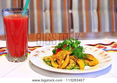 dish for vegetarians vegetables grilled and tomato juice
