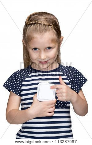 Young girl turning off light switch