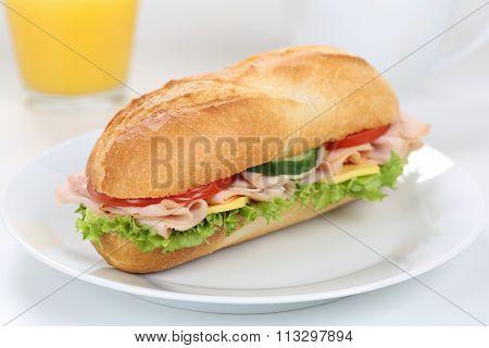 Sub Deli Sandwich Baguette For Breakfast With Ham And Orange Juice