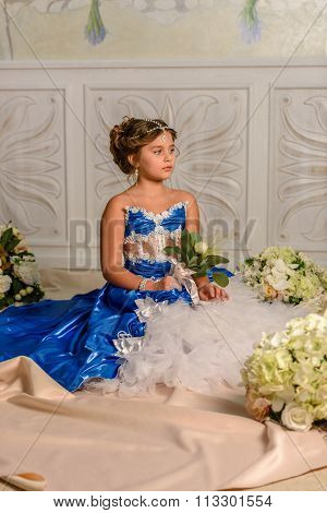 Girl  in a beautiful dress with flowers