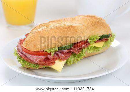 Sub Deli Sandwich Baguette For Breakfast With Salami Ham And Orange Juice