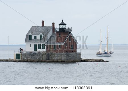 Sailboat Passes Maine Lighthouse