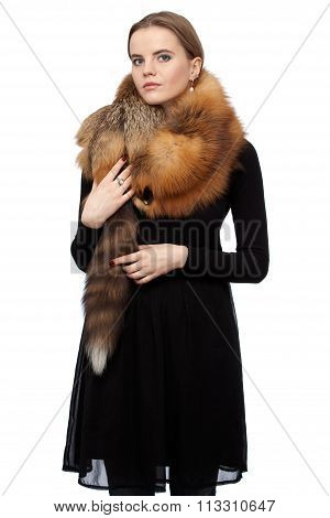Woman In Black Dress With A Fur Collar