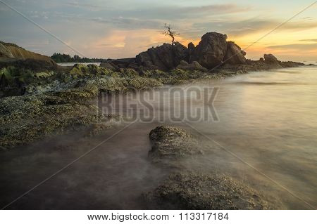 Bonzai Layangan Labuan Rock Over Beautiful Sunset.