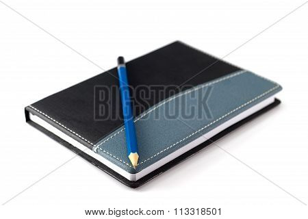 Blue Pencil On Black Leather Moleskin Notebook