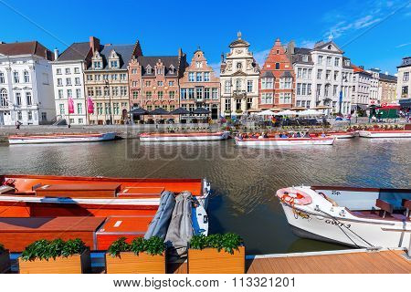 GHENT, BELGIUM - SEPTEMBER 02, 2015: tourist boat with unidentified people at the Graslei. Ghent is famous for the medieval old town and is Belgiums 2nd largest municipality by number of inhabitants