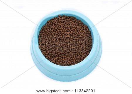 Pet food in blue color plastic dishware on white background isolated