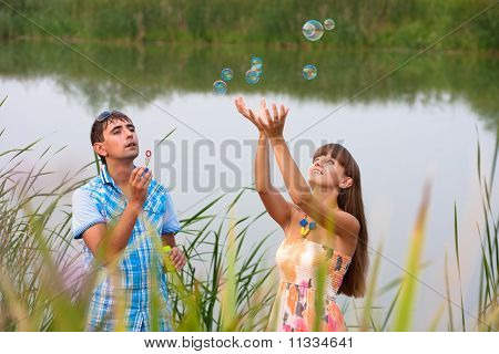 The Pair Starts Up Soap Bubbles