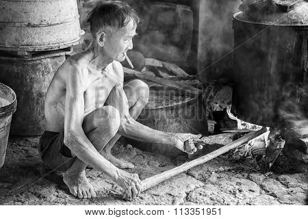 The man cooking water firewood