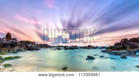 Dance of cloudy dawn on coastal reefs