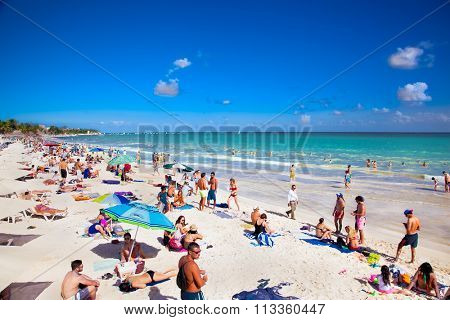 PLAYA DEL CARMEN,MEXICO-NOV 29, 2015: Unidentified tourists on the beach of Playacar at Caribbean Sea in Mexico, Nov 29, 2015. This resort area is popular destination with the most beautiful beaches.