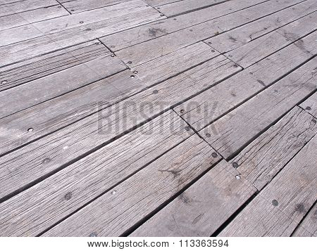 Weathered timber planks at a pier
