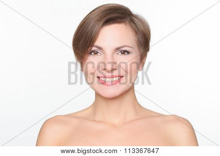 portrait of a beautiful woman with bare shoulders and short hair. smiling.