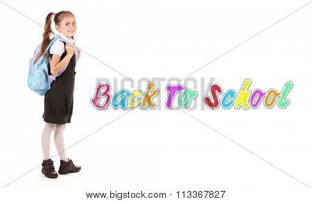 Portrait of beautiful little girl in school uniform with backpack isolated on white