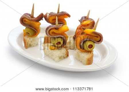 spanish tapas pinchos, anchovy olive and paprika