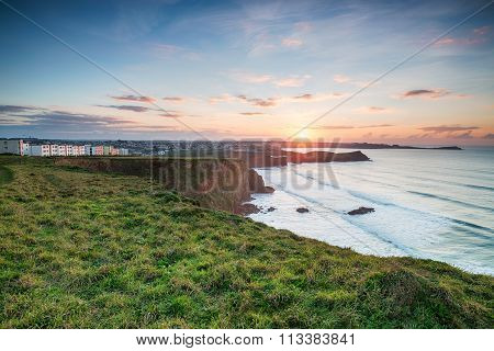 Sunset Over Porth In Cornwall