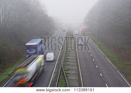 Traffic On A Misty Road