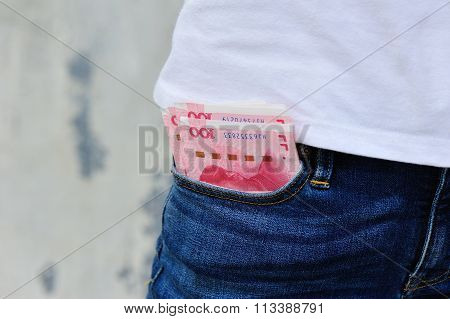 young woman with cny cash in pocket