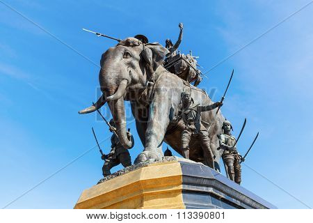 AYUTTHAYA,THAILAND-DECEMBER15,2014: Queen Suriyothai Monument, that depicts a fierce looking King Maha Chakkraphat on his war elephant, surrounded by Siamese soldiers, immediately after his queen fell
