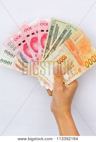 closeup of people hand with international cash