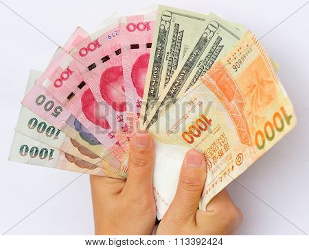 closeup of people hands with international money