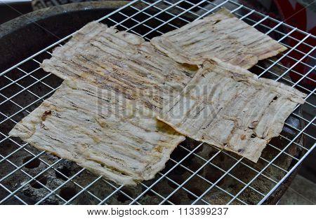 grilled flat banana Cambodian food on gridiron