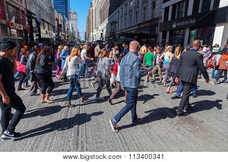 NEW YORK CITY - OCTOBER 06, 2015: crowds of people crossing a street in midtown Manhattan. The metropolitan area NYC is one of the most important economy areas and commercial center of the world