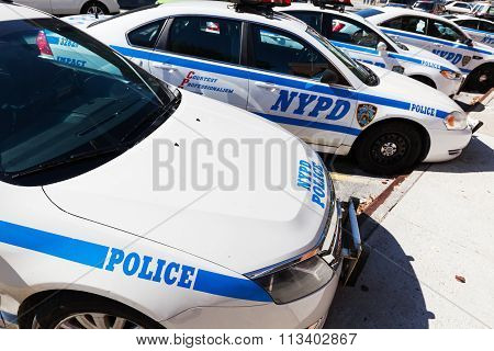 NEW YORK CITY - OCTOBER 11, 2015: Police cars at a Police Department in the Bronx. The NYPD is one of the oldest police departments established in the US, tracing its roots back to the 17th century.