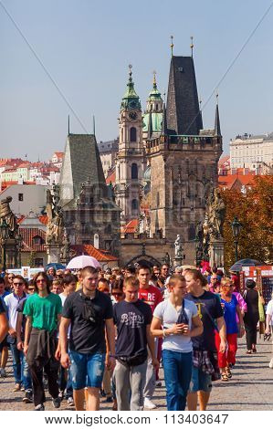 PRAGUE, CZECHIA - SEPTEMBER 05: bridge tower of the Charles Bridge at the lesser town with unidentified people on September 05, 2014 in Prague. Center of Prague is protected by UNESCO world heritage