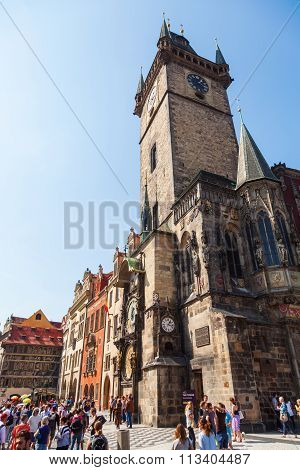 P'RAGUE - SEPTEMBER 04: tower of the historical City Hall Tower at the Old Town Square with unidentified people , September 04, 2014 in Prague. The historic city centre is UNESCO protected
