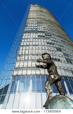 BONN, GERMANY - JANUARY 31: Deutsche Post Tower with the sculpture -Mercurius- in front on January 31, 2014 in Bonn. The tower is with 162,5 meters the 11th largest in Germany.