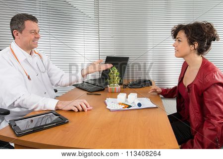 Happy Medical Rep In A Meeting With A Cheerful Doctor