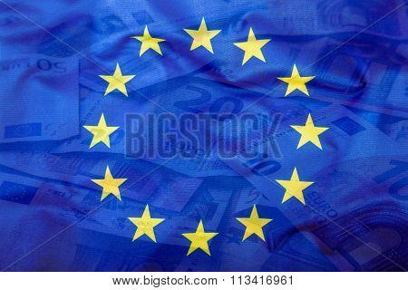 Euro flag. Euro money. Euro currency. Colorful waving european union flag on a euro money background