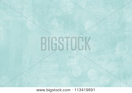 A teal blue abstract background.