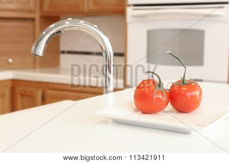 Tomatoes on a white kitchen counter.