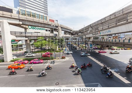 BANGKOK, THAILAND - DECEMBER 11, 2014: street scene at the Silom Road in Silom district with unidentified people. Bangkok is one of the most important economic and transport centres in South-East Asia