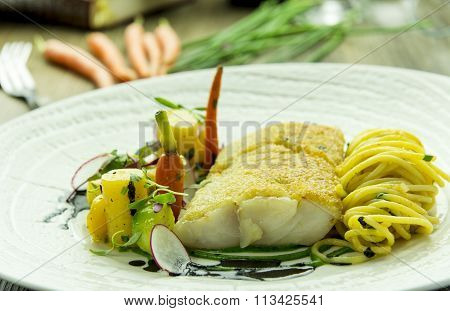Cod fillet with spinach puree and spaghetti