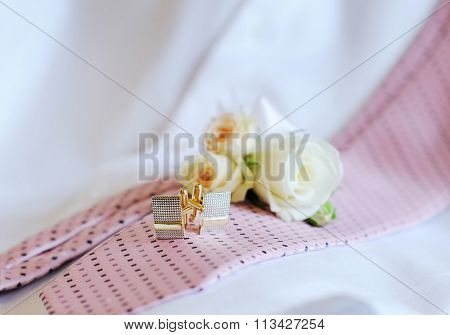 Wedding Rings, Cufflinks Tie On The Couch