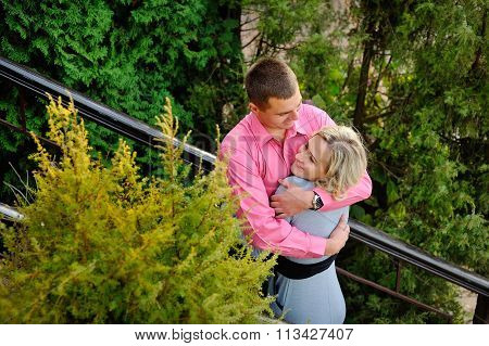 Happy Couple In Fall Under Leaves Of A Broad Leaved Lime