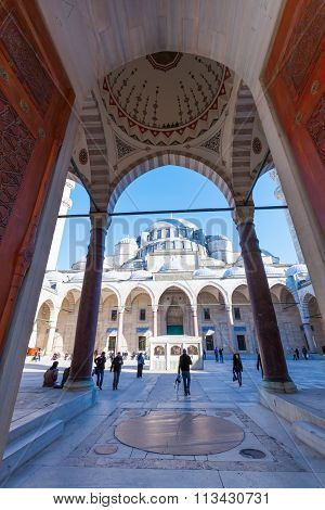 ISTANBUL, TURKEY - APRIL 10, 2015: Sueleymaniye Mosque with unidentified people.  Its an Ottoman imperial mosque and the largest mosque in the city, and one of the best-known sights of Istanbul.