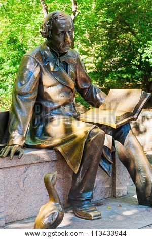 NEW YORK CITY-OCTOBER 06, 2015: sculpture of Hans Christian Andersen in Central Park. The 1956 work by sculptor Georg J Lober was constructed with contributions from Danish and American schoolchildren